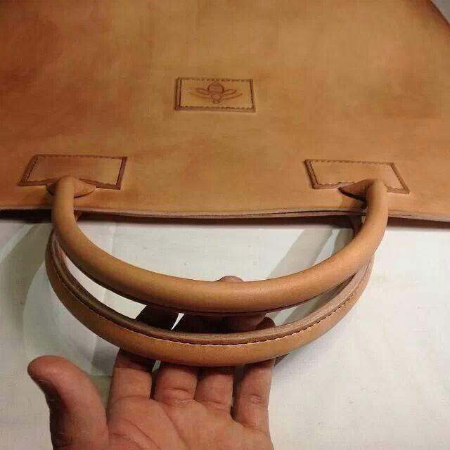Go Native. Hand sewn leather bag by Native mixed medium designer Isaac