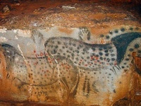 Petroglyphs are scratched or chipped into the rock wall of a cave to make a picture or symbol. Pictographs are the result of painting or drawing onto rock. Sometimes  a picture was the result of  a combination of both methods.