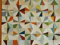 quilts and quilt ideas, I like the geometric traditional patterns mostly (more than the free-form)