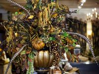 Pumpkins and feathers and florals oh my.