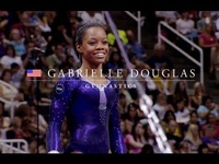 The 16-year-old Douglas is the first African-American woman to win gymnastics' biggest prize.