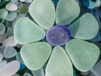 eyecatching seaglass found on the shore and then loving crafted into something even more beautiful ...