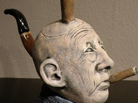 Human faces, abstract and realistic; vessels, plates, and wall pieces