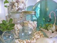 coastal vignettes and accessories: boats, shells, lighting, pillows, frames, furniture