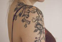 Tattoos / by Erika Buzalka