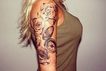 tattoos and piercings / by Brittni Chapman
