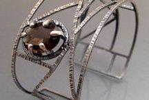 Bracelets and cuffs / by Viki Robinson Twyman