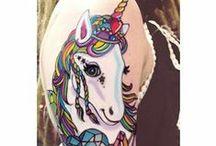 Tattoos / by Teresa Downey