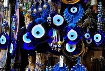 乇vιℓ乇yεظر ✖нαϻsαخمسة / I became acquainted with the evil eye in Greece & Turkey travels. I've no personal belief in its power; an attractive symbol. Idea appeared in Old Testament translations (Tirgumim), extended belief of Mediterranean/Asian tribes/ cultures, believed to cause injury-bad luck for person at whom directed for reasons of envy/dislike. Also refers to inflicting negativity. An evil eye's given to others who remain unaware. A hamsa also protective; different attributes/history. / by Sandra Lee Larsen