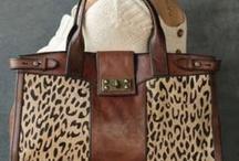 Purses, purses and more purses / by Ada Maldonado