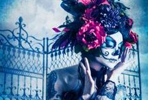 Dia de Los Muertos Inspiration Images / Ideas to consider for Le Diner 2013: A sexier version of DDLM. This is an all white party, but we are going to mix it up a bit for our group. Attire: ALL White! That is a MUST! Makeup & Hair color palette: White +Black +ONE color (pale preferred & glitter recommended!) Flowers, Funky Hats, Gloves, Beads and of course, the makeup! Table Styling: WHITE design, candles, one color (orange marigolds), myriad of candles, hanging paper stencil, gold & silver skulls, white crosses... and great food! / by Janice Dodge