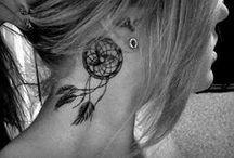 Piercings & Tattoos / by Lauren Collie