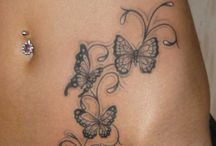 tatoos and piercings / by Crystal Mahon