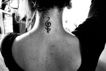 Tattoos and Piercings / by Cait