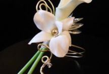 Boutonnieres / by Petals and Leaves Wedding and Event Florist