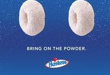 """The One and Only Donette  / Sure, the powered sugar is a little messy, and maybe not the best thing for your car's upholstery, but for millions of Americans, it's all part of the irresistible charm of Hostess Donettes. Since being introduced in the 1930s, the little """"gems"""" have attracted fans in many circles – from hungry commuters to lunchbox toting tikes.  / by Hostess Snacks"""