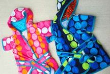 Bathrobes, Towels, Pajamas, Swaddlers, Swimsuits, Wipes, Blankets / by Melissa McNerney