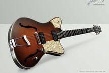 Guitars / by Serena Howlett