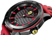New Scuderia XX Collection / SCUDERIA XX is the most adventurous watch of the Scuderia Ferrari collection. Instantly recognizable, thanks to the coloured ring positioned below the bezel, SCUDERIA XX has a distinctive 48 mm stainless steel case. The multi-level dials are enhanced by stylish details such as metallic reflectors, carbon fibre texture effect and the applied numbers and digits.  / by Ferrari Store