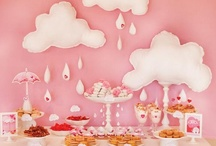 "Showered With Love / This ""Showered with Love"" baby shower is filled with girlie, rain-inspired details like sequin embellished umbrellas, fluffy felt clouds, glittery pacifiers & hearts, and a button-adorned cloud shaped diaper cake. / by HUGGIES Baby Shower Planner"
