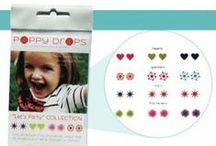 """A Brand's Story: Poppy Drops / Poppy Drops was born out of a common dilemma - when to pierce a little girl's ears? Founder Shelly wanted to keep her little girl """"little"""" as long as possible so she developed their unique, water-transferred pierce-free earrings so that her daughter could have all the fun of """"grown-up earrings"""" without the complications and responsibility of permanent piercing. Poppy Drops really are the perfect, pierce-free alternative... long-lasting, simple to use and totally safe!  / by Raspberry Kids"""