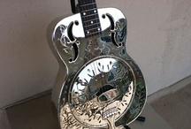 badass guitars / by Marty Bigperm