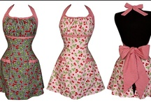 """Awesome aprons / """"I don't think our kids know what an apron is.  The principal use of Grandma's apron was to protect the dress underneath, because she only had a few, it was easier to wash aprons than dresses and they used less material, but along with that, it served as a potholder for removing hot pans from the oven. It was wonderful for drying children's tears, and on occasion was even used for cleaning out dirty ears. From the chicken coop, the apron was used for carrying eggs."""" / by Julia Jones"""