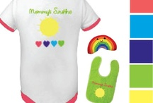 Mommy's Baby - Design A Doll Outfit Option 1 / The Mommy's Baby ensemble includes a onesie, a jacket, hat, socks, bottle, blanket, bib and toy all based on a sunshine, mommy loves baby theme. *Note: some items, colors and graphics may change in final production. / by Paradise Galleries