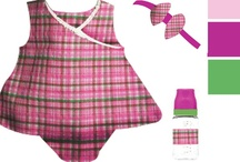 WINNER! - Plaid Party - Design A Doll Outfit Option 5 / The Plaid Party ensemble includes a onesie, an additional onesie, hair bow, socks, bottle, blanket and bib all based on a sunshine, mommy loves baby theme. *Note: some items, colors and graphics may change in final production. / by Paradise Galleries