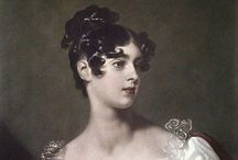 Regency Hairstyles / When men wore long sideburns as a matter of course and ladies adopted a classical, more natural look with curls, braids, ribbons, and pins. / by Vic (Jane Austen's World)