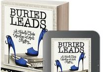 "BURIED LEADS / A board for book two in the Headlines in Heels Mystery Series by LynDee Walker. ""When an Armani-clad corpse turns up in the woods, crime reporter Nichelle Clarke smells a scoop. A little digging, and Nichelle uncovers a web of corruption that stretches all the way to Washington, D.C. Politics. Murder. And a dead lobbyist. It's everything Nichelle's ever dreamed of."" / by Henery Press"
