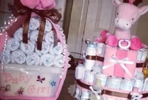 Baby Shower Gifts and Diaper Cakes / by Cristiana Poe