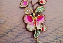 One of a kind hand embroidered and beaded jewelry from Miao ethnic  / Every piece is an exquisite piece an art.  All crafted by a jewelry artist from Miao ethnic, Yunnan, China / by Zengerine