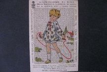 Embroidery on fabric and on paper. Many stitching cards for children / The designs here are from all different eras. Many were given as premiums / by Laura Jones