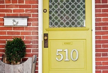 front doors / grey body with white trim and cedar accents.  fun pop of color front door-chartreuse, chrome yellow, orange or blue / by C Brown