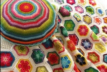 new crochet blanket inspiration / I'm designing a new crochet blanket - big colorful flowers on a white background. I'm using this board to work out a few difficulties I'm having with flower-shape vs. block shape. Looking for good examples! / by Polka Dot Cottage