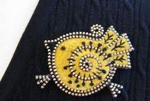 Felt, yoyos, embroidery, pillows / by Ludmila Mesteková