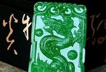 Jade Carvings & Sculpture - Jadeite, Nephrite / Jade Carvings & Sculpture- Since at least 2950 BC, jade has been treasured in China as the royal gemstone. Jade is a bridge between the spiritual and the material world. Jade was thought to preserve the body after death and can be found in emperors' tombs from thousands of years ago. Nephrite is Ca2(Mg, Fe)5Si8O22(OH)2. Jadeite is NaAlSi2O6 or Na(Al,Fe3+)Si2O6. Jade occurs in a wide variety of colors that include: green, white, lavender, yellow, blue, black, red and gray.  / by Elizabeth Pings