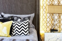 Master Bedroom / So far, the theme is navy accent wall with soft white walls, grey headboard and brass accents.  / by Kami Corbett
