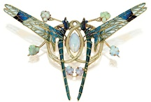 """10 -  Art Nouveau Jewelry (1895–1915) / Art Nouveau jewelry features natural designs such as flowers and butterflies and were generally considered """"romantic."""" Art Nouveau was a style popular from about 1895 until World War I. The style actually began around 1875 in Paris, and its influence went throughout the western world. Art Nouveau jewelry follows curves and naturalistic designs, especially depicting long-haired, sensual women, sometimes turning into bird-like or flower-like forms.   / by Solange Spilimbergo Volpe"""