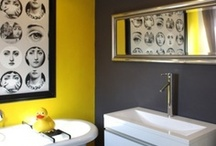 Dark bathrooms with pops of bold colour / If you want to create a bathroom that's ideal for a family but still as sophisticated as the one you had when you were a hip twosome, choose cool grey - and add pops of bright shades to bring it to life. / by Bathrooms.com