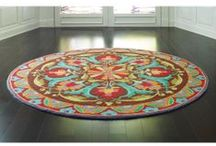 Round Rugs / Try the fun of a round rug in an entrance hall, dining area, bedroom or play space! Round rugs recall the humble charms of the rag rugs, braided rugs and hooked rugs our Colonial ancestors handcrafted for their homes. A round rug is often a good solution in a more square-shaped room. Here's a round-up of great ways to make shape, as well as color and pattern, a design element in your room.  / by Company C