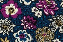 Inspiration: African Violet / White, gold, plum and blue blooms are scattered across a tonal blue leopard-spotted ground. Shop African Violet at www.verabradley.com. / by Vera Bradley