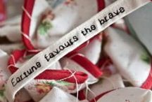 Fabric Fortunes made by 2 Green Monkeys / Fabric fortunes © are unique handmade party favours, made in the shape of fortune cookies. Each cookie comes loosely hand stitched, with thread that pulls open to view the embroidered fortune message inside. / by 2 Green Monkeys