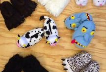 Animal Slippers for Men, Women and Children / Find some of the coolest animal slippers around. Animal slippers come in a huge variety from animals like bunny slippers and cows to fantasy like dragons and yeti's.  You can find animal slippers shaped like cow's hoofs or bear's claws and even just animal print slippers like zebra, cheetah and more.  Find and share your favorite pairs of animal slippers on this pin board.   / by Crazy For Bargains Pajamas