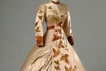 """Style:  Victorian Era 1837-1901 / The Victorian era began in 1837, during the rule of Queen Victoria in the United Kingdom. This style remained until 1901 when the less conservative fashions of the Edwardian era took center stage with the rule of Victoria's son, King Edward.   Victorian Fashion was """"ladylike"""" and styles were modest, as well as hot, heavy and uncomfortable. Architecture was ornate and colorful with many architectural details and flourishes.     / by Marcie A."""