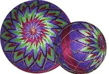 Temari Balls / I was not familiar with these lovely hand balls. They originated in China & were introduced to Japan in the 7th century AD. Originally made from old kimonos, as time went by, traditional temari became an art, with the functional stitching becoming more decorative and displaying intricate embroidery.  / by Heather Junge