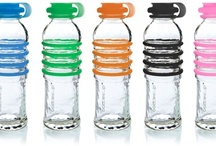 """BottlesUp / The reusable glass water bottles from BottlesUp. Made entirely in North America, the bottles are made from a minimum of 75% post-consumer recycled glass sourced onsite. Colorful silicone grippers provide """"gription"""" and a secure top. Bottles are BPA-free and free of any plastics. #glass #bottle #bpafree / by BottlesUpGlass"""