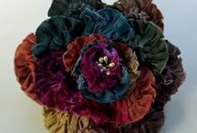 FABRIC FLOWERS / I AM SUCH A MAJOR FAN OF ALL TYPES OF FABRIC FLOWERS. I JUST CAN'T STOP PINNING THEM. THERE IS A LOT OF CRAFT TALENT OUT THERE. / by Cindy Holmes