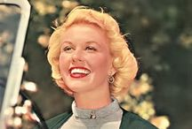 Doris Day / Doris Day (born Doris Mary Ann Kappelhoff, April 3, 1924) is an American actress, singer, and animal rights activist. Day was ranked the biggest box-office star for four years (1960; 1962–1964) and ranked in the top 10 for 10 years (1951–1952; 1959–1966). She became the top-ranking female box-office star of all time and is currently ranked sixth among the top 10 box-office performers (male and female), as of 2012. / by Cathryn Davis